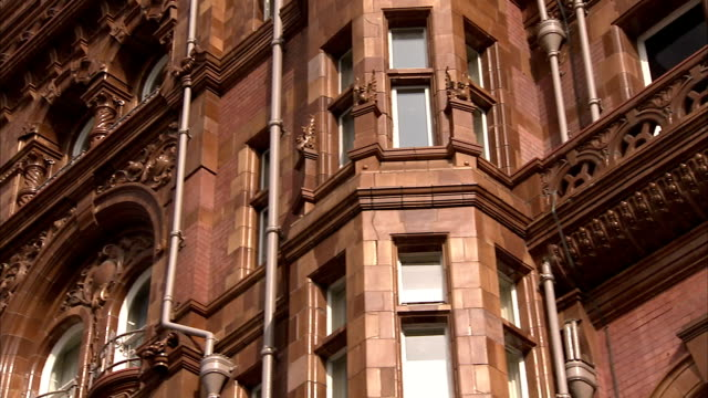 little balconies hang out from windows on the midland hotel in manchester england. available in hd. - northwest england stock videos and b-roll footage