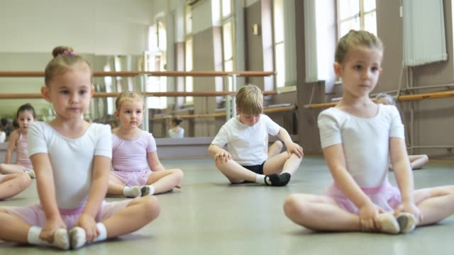 little ballerinas and ballet dancer stretching before ballet class - ballet dancing stock videos & royalty-free footage