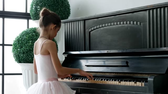little ballerinas playing piano - ballet performance stock videos & royalty-free footage