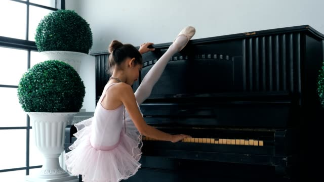 little ballerinas stretching on piano - ballet performance stock videos & royalty-free footage