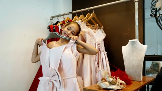little ballet girl choosing clothes on rack - dress stock videos & royalty-free footage