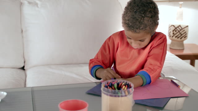 hd: little biracial boy drawing with crayons - crayon stock videos and b-roll footage