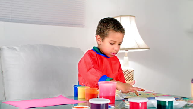hd: little biracial boy smiling after finger painting - finger painting stock videos and b-roll footage