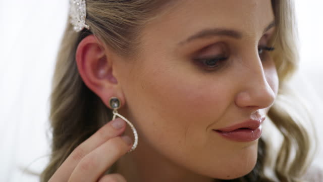 a little bling for a big occasion - earring stock videos & royalty-free footage