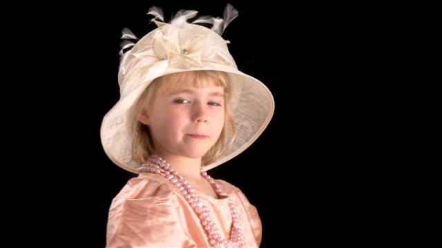 little blond girl in mama's dress