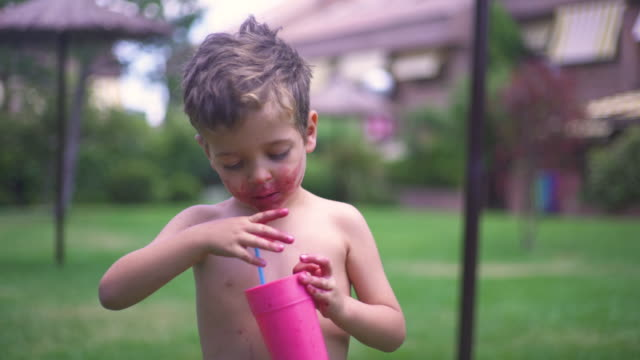 little boy, 5 years old, drinking from a pink glass with straw - blue eyes stock videos & royalty-free footage