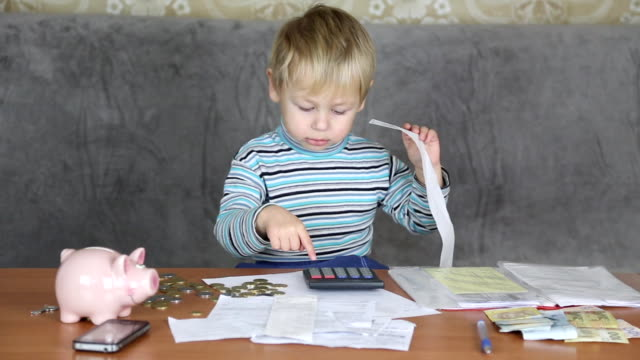 little boy accountant - coin stock videos and b-roll footage