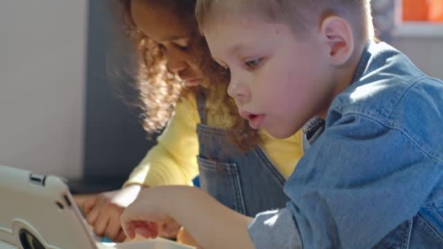 Little boy and girl building plastic model together