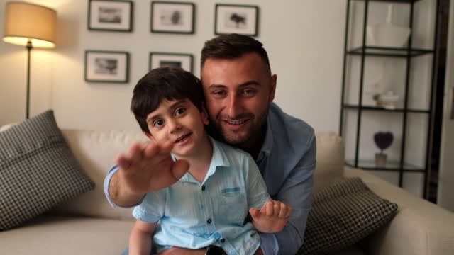 little boy and his father using technology and having video call - genderblend stock videos & royalty-free footage