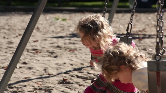 ms little boy and little girl playing  on swing in park / toronto, ontario, canada - kelly mason videos stock videos & royalty-free footage