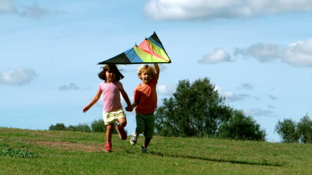 little boy and little girl playing with kite - kid with kite stock videos & royalty-free footage