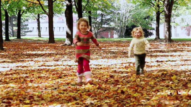 ws little boy and little girl runing toward / toronto, ontario, canada - kelly mason videos stock videos & royalty-free footage