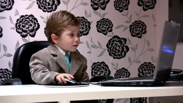 Little boy and office