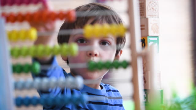 little boy at pre school classroom learning how to count using a colorful abacus (picture taken in a real us classroom) - preschool stock videos & royalty-free footage