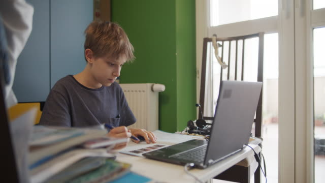 little boy attending to online class in his room. - pre adolescent child stock videos & royalty-free footage