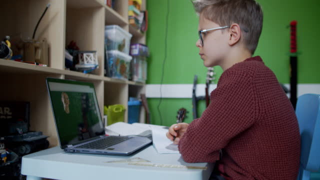 little boy attending to online school class from his room. - laptop isolated stock videos & royalty-free footage