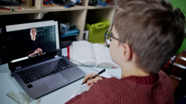 little boy attending to online school class from his room. - remote location stock videos & royalty-free footage
