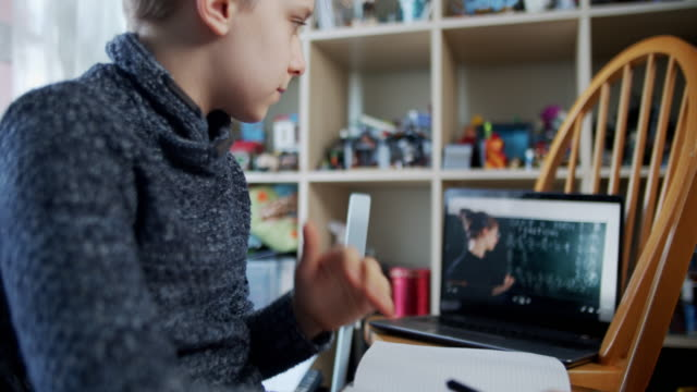 little boy attending to online school class from his room. - attending stock videos & royalty-free footage