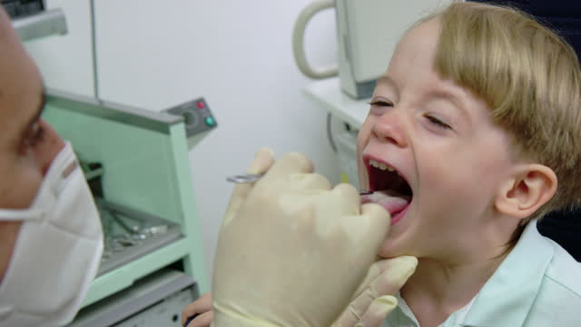 little boy being examined by otolaryngologist in clinic - lymph node stock videos & royalty-free footage