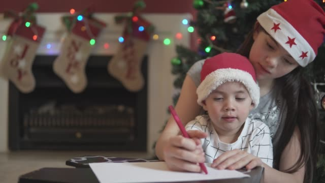 little boy being helped by his older sister to write a letter to santa - letter stock videos & royalty-free footage