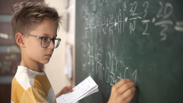 little boy calculating fractions on math lesson - mathematician stock videos & royalty-free footage