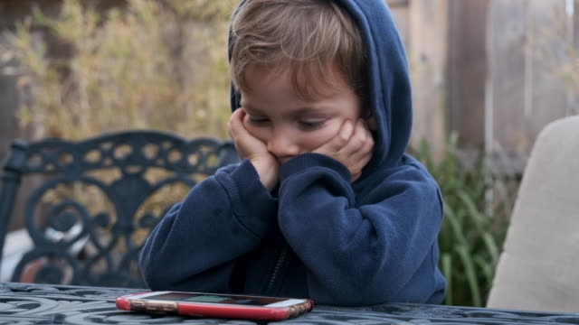 little boy child looking at his smart phone - boys stock videos & royalty-free footage