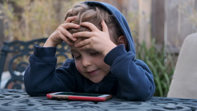 little boy child looking at his smart phone - hooded shirt stock videos & royalty-free footage