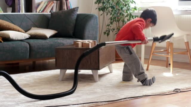 little boy cleaning floor with vacuum cleaner - chores stock videos & royalty-free footage