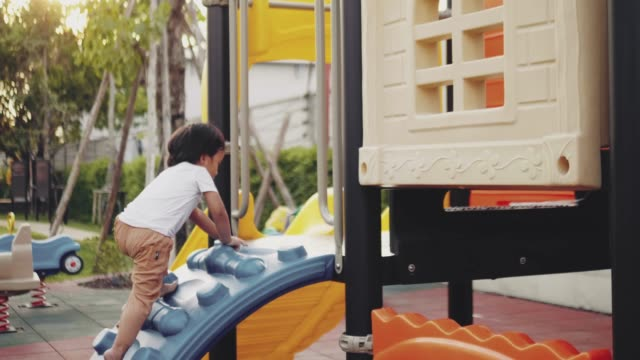 little boy climbing on a jungle gym - playground stock videos & royalty-free footage