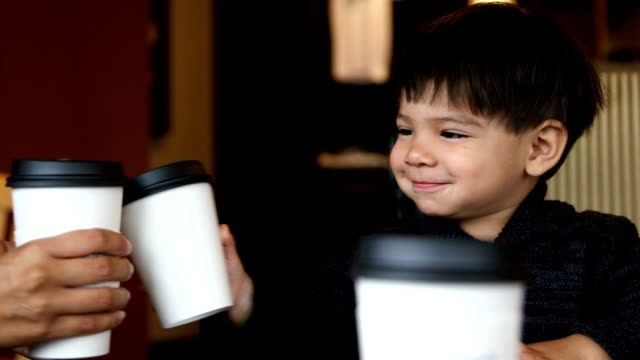 little boy clinks coffee cups - hot chocolate stock videos and b-roll footage