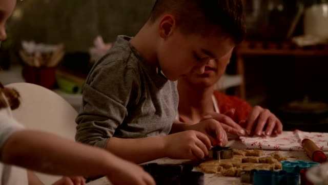 little boy concentrating while cutting out shapes in a cookie dough - baking stock videos & royalty-free footage