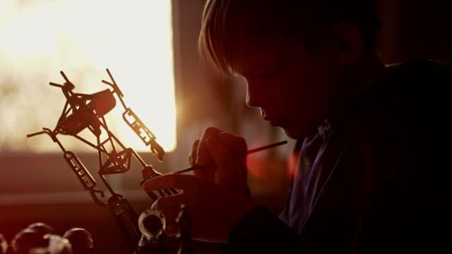 little boy constructing a robot skeleton. - exoskeleton stock videos & royalty-free footage