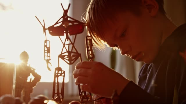 little boy constructing a robot skeleton. - boys stock videos & royalty-free footage