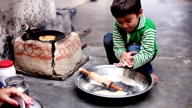 little boy cooking food - developing countries stock videos & royalty-free footage