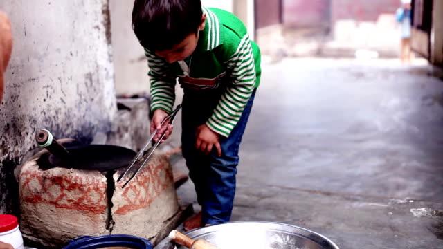 Little boy cooking food