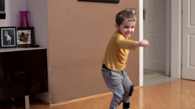 little boy dancing and imitating boxer movements - toddler stock videos & royalty-free footage