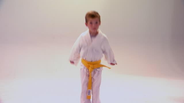 little boy demonstrating tae kwon do bow