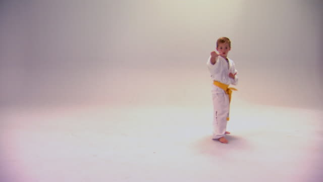 little boy demonstrating tae kwon do moves - karate stock-videos und b-roll-filmmaterial