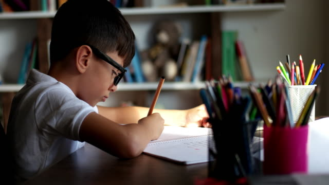 little boy doing homework at home - one boy only stock videos & royalty-free footage