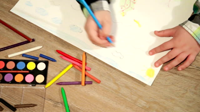 little boy drawing on white paper - crayon stock videos & royalty-free footage