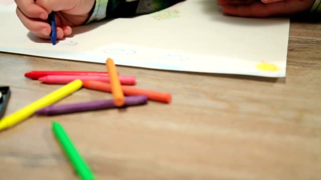 little boy drawing on white paper - crayon stock videos and b-roll footage