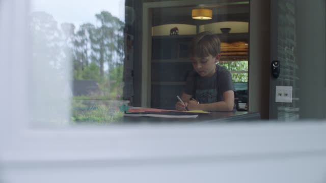 little boy drawing with markers in his kitchen - remote location stock videos & royalty-free footage