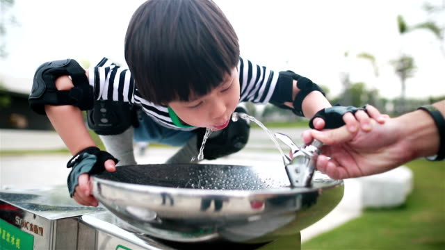 little boy drinking tap water - drink stock videos & royalty-free footage