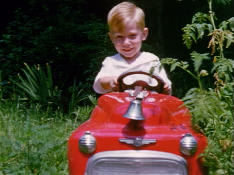 1955 HOME MOVIE little boy driving red toy car towards camera + waving to camera / Staten Island