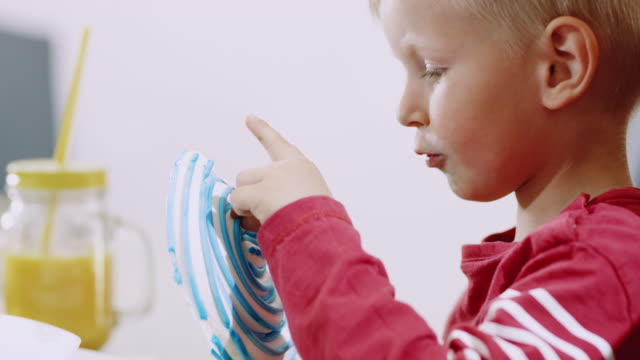 ms little boy eating a lollipop - lollipop stock videos and b-roll footage