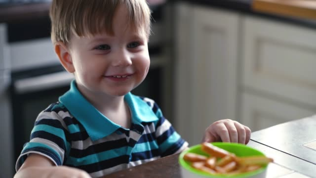 little boy eating at kitchen - spoon stock videos & royalty-free footage