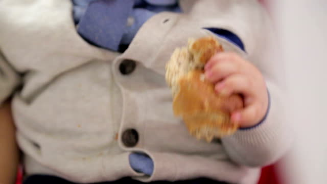 Little boy eating bread