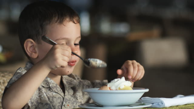 little boy eating dessert
