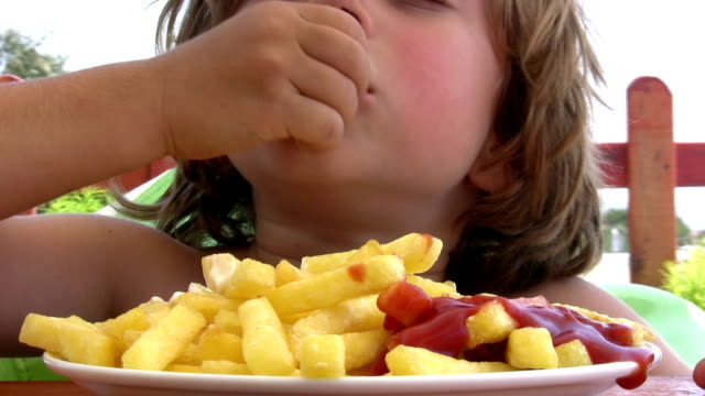little boy eating french fries - ketchup stock videos and b-roll footage