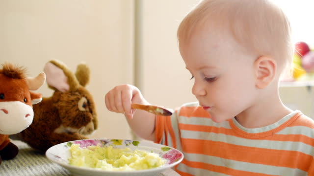 little boy eating mashed potatoes - hungry stock videos and b-roll footage